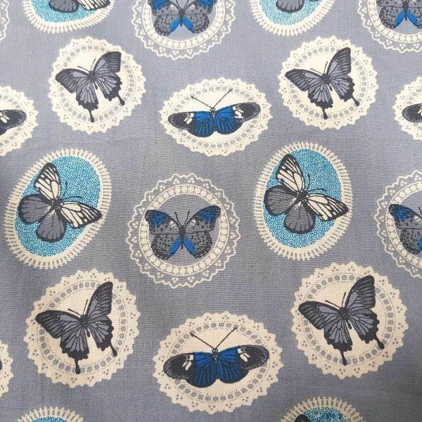 Stoff Meterware Baumwolle grau Schmetterlinge Popeline weiß blau Kleiderstoff