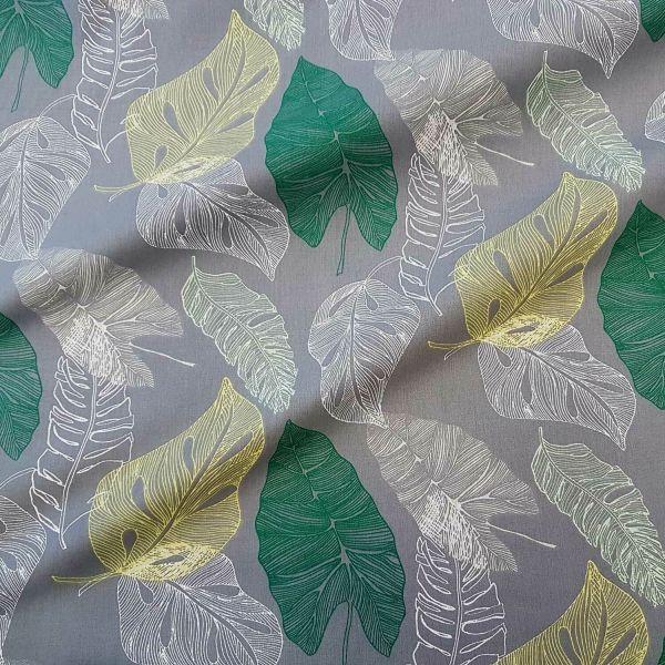 Stoff Meterware Baumwolle grau Blätter grün gelb weiß hyggelig
