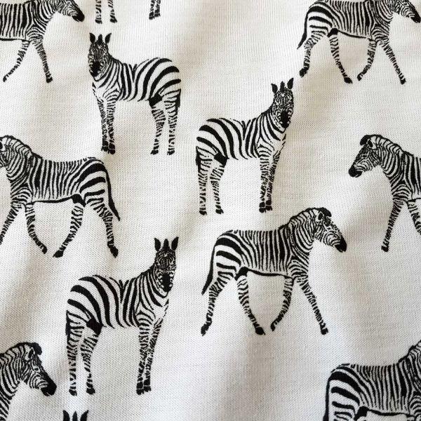 Stoff Meterware Jersey Zebra weiß gelb colour changing UV Sonnenlicht