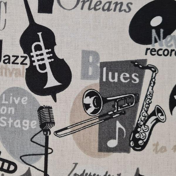 """Stoff Baumwolle """"Jazz"""" Musikinstrumente beige grau schwarz 0,5"""