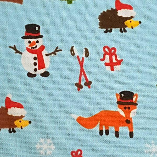 Stoff Meterware Weihnachtsstoff hellblau Schneemann Fuchs Meterpreis Baumwolle