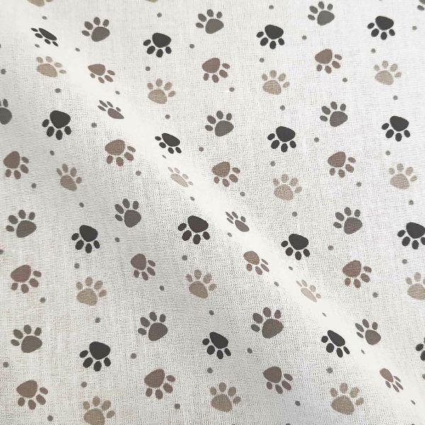 Stoff Meterware Baumwolle Pfoten beige taupe grau schwarz 0,5
