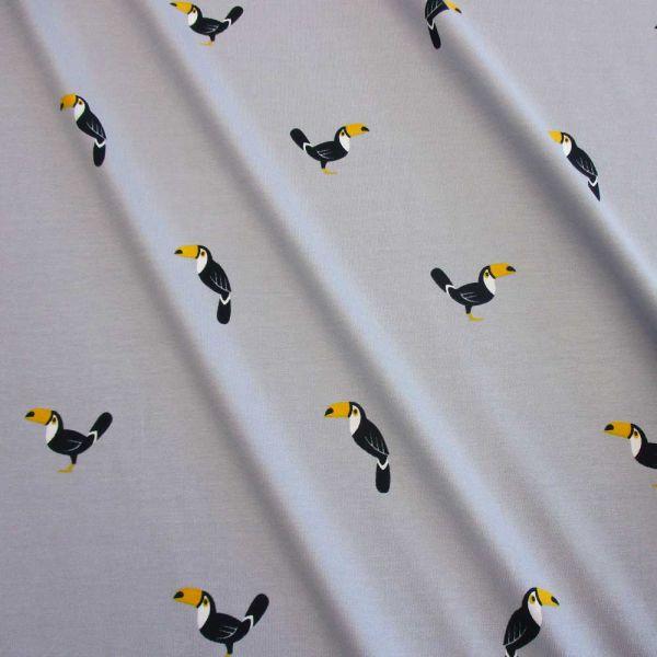 Stoff Jersey Baumwolle grau Tukan Trend