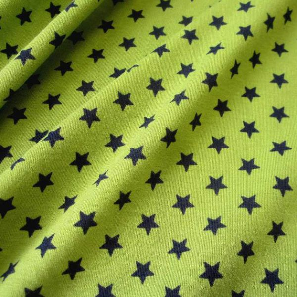 Stoff Baumwolle Jersey Sterne Stern kiwi schwarz